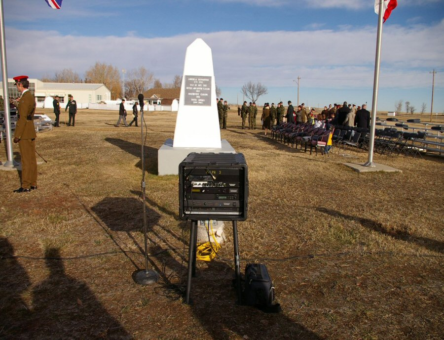 A Technomad Turnkey PA System in use for a Remembrance Day ceremony at CFB Suffield in Alberta. The Turnkey PA shock-mount signal processing rack is visible here, with a six-channel mixer, amplifer and a Technomad SuperConductor military mp3 player/recorder for instant playback of audio files at the event.